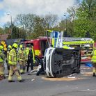 A marked police car overturned following a collision in Chadwell Heath