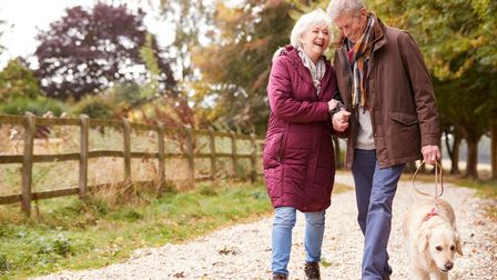Retired couple on a walk in Hatfield discussing pensions