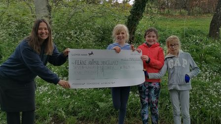 Ferne Animal Sanctuary's Emma Green with Maddie Dowell, Poppy Jenns and Paloma Moorley.