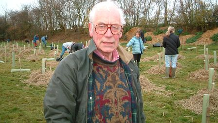A man stands in a field: Peter Sanders
