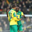 Goal maker Vadis Odjidja-Ofoe of Norwich and goalscorer Alexander Tettey of Norwich embrace and cele