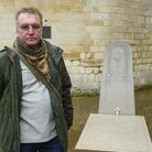 Richard Knight, military historian, with Edith Cavell's tombstone at Norwich Cathedral. Picture: Dan