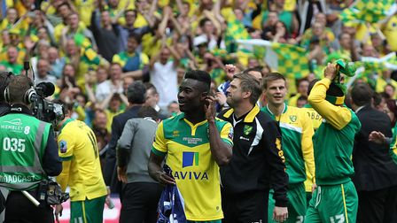 The Norwich fans and players celebrate victory at the end of the Sky Bet Championship Play-off Final