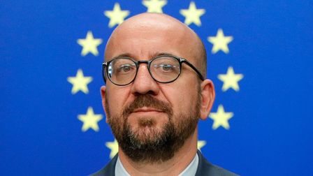 TOPSHOT - Belgium's Prime Minister Charles Michel looks on as he addresses the media after the EU le