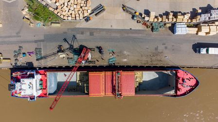 Timber being off-loaded from the Storetbeker (Gibralter) at the Port of Wisbech.River Nene, Wisbec