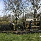 Mark Reddy andDavid Millband help to dismantle the old pirate ship play area inChrishall