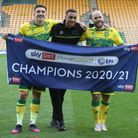 Jordan Hugill of Norwich, Adam Idah of Norwich and Teemu Pukki of Norwich celebrate winning the Cham