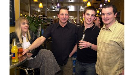 Customers sharing a drink and a chat at Splitz Bar in Felixstowe in 2002