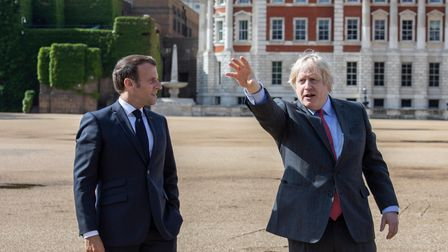 Prime Minister Boris Johnson (right) and French president Emmanuel Macron watch a flypast of the Red