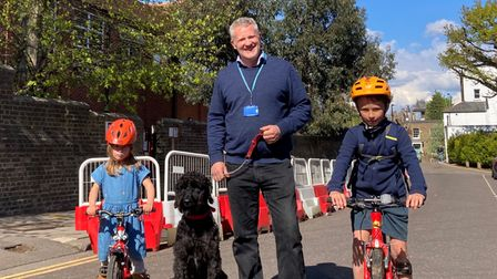 Highgate primary headteacher William Dean with pupilsOlivia and Elliot Holloway - and Horace, the school dog