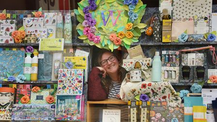 Louisa Theobald, children's expert at Waterstones, with her floral inspired creation in the shop win