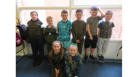 Children at Sprites Primary Academy in Ipswich on their Green Day for Deaf Awareness Week