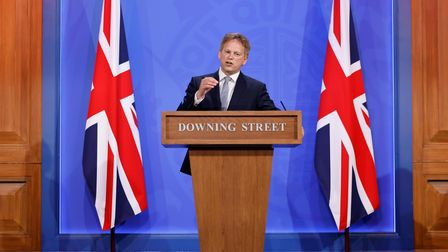 Transport Secretary Grant Shapps explaining new travel rules during a COVID-19 media briefing in Downing Street.