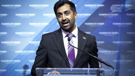 Scottish National Party's (SNP) Humza Yousaf delivers his speech on stage after retaining his seat f