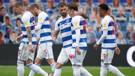 QPR's Stefan Johansen celebrates with teammates after scoring their second goal against Luton inthe Championship