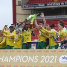 Grant Hanley and Alex Tettey lift the Championship trophy aloft after Norwich City's 2-2 draw at Barnsley