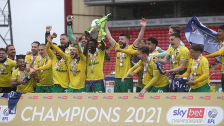 The Norwich players lift EFL Championship trophy at the end of the Sky Bet Championship match at Oak