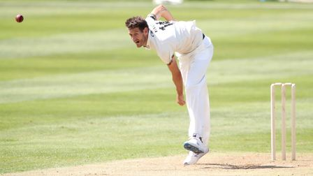 Gloucestershire's David Payne in bowling action