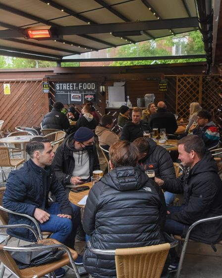 Despite the rain, people enjoy the pub garden at the Whalebone on Magdalen Road in Norwich. Picture: