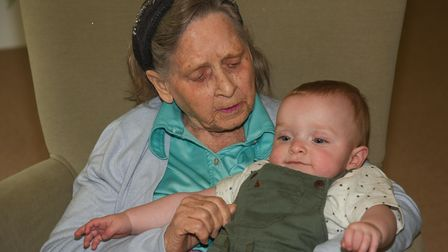 Pat Allington, a resident at Buckingham Lodge Care Home, meeting her twin great grandchildren for th