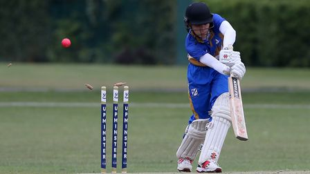 Tom Daniels of Upminster is bowled out by Ilford's Harsh Kumar