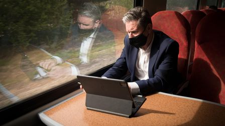 Leader of the Labour Party Sir Keir Starmer works on a train as he travels across England