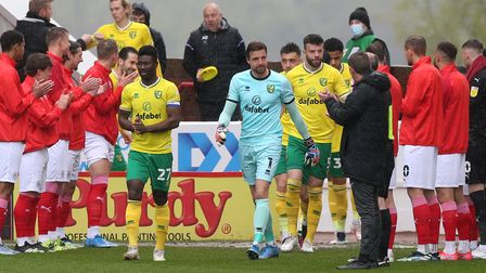 Alexander Tettey of Norwich leads his team out with a guard of honour provided by the Barnsley playe