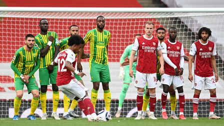 Arsenal's Willian takes a free kick during the Premier League match at the Emirates Stadium, London.