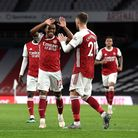 Arsenal's Willian celebrates scoring their side's third goal of the game during the Premier League m