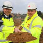 Paul Pitcher of contractor Wellington (left) and Andrew Savage of Broadland Housing Group cut the fi