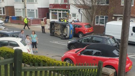 A car ended up on its side after a crash between aVauxhall Crossland x Griffin and a parked Fiat 500