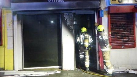 Firefighters at afast food shop in the Stratford High Street.