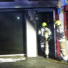 Firefighters at a fast food shop in the Stratford High Street.