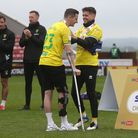 Xavier Quintilla of Norwich helps Kenny McLean of Norwich put on his medal at the end of the Sky Bet
