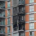 Damage to a 19-storey tower block in New Providence Wharf in London, where the London Fire Brigade (