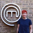 Jane Wyndham of Wyndham Hair in Hornchurch infront of the MasterChef sign
