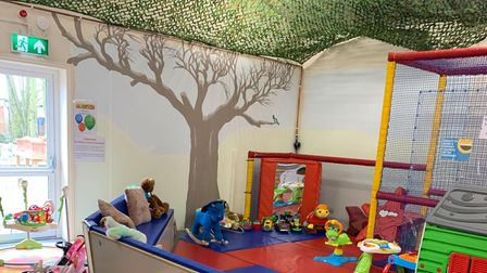 Tumbledown soft play centre with foam mats, tables and play house