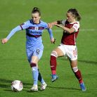 West Ham United's Kate Longhurst (left) and Arsenal's Jordan Nobbs battle for the ball during the FA