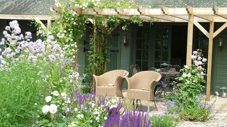 A relaxing garden patio area with chairs