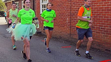 Runners setting off from the Exhibition Pub in Godmanchester in September 2020.