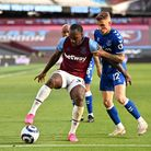 West Ham United's Michail Antonio and Everton's Lucas Digne (right) battle for the ball during the P