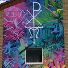 Local artist Johnny Barton come and do a wonderful piece of art on our school walls