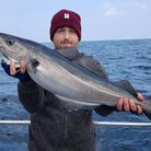 Dan Teague with an 8lb Coalfish on Silver Halo