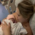 Jessica Walden holding new baby after giving birth