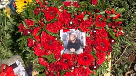 Flowers have been laid at the bushes where the body of Maria Rawlings was discovered in Little Heath.