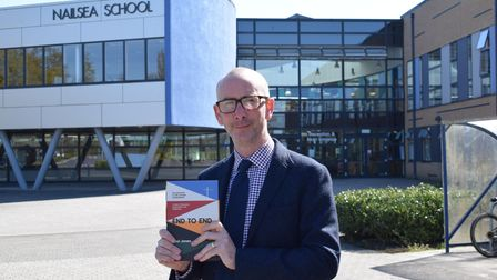 Nailsea teacher Paul Jones with his book End to End