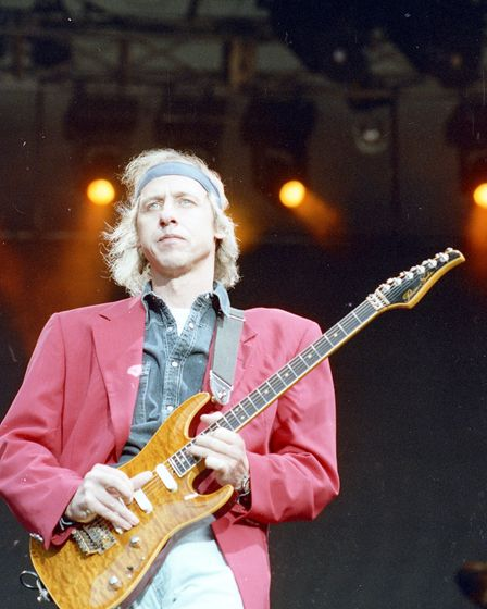 Mark Knopfler, front man of Dire Straits, performing at Portman Road in 1992