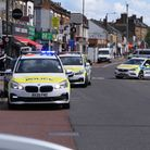 Shots were fired in Dudden Hill and a person taken to hospital