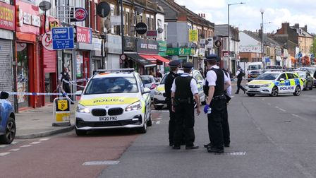 Police in Dudden Hill where shots were fired and a person taken to hospital