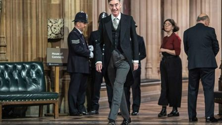 Leader of the House of Commons Jacob Rees-Mogg (C) prepares ahead of the State Opening of Parliament